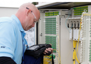 An AT&T fiber technician installing office connection.
